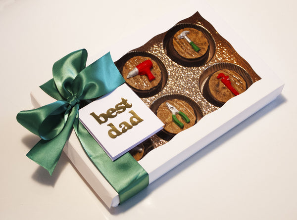 Image of white box containing mini edible tools on chocolate covered oreos as a guy gift for holiday or Christmas cookie delivery from Benedict Treats