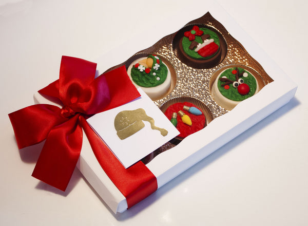 Image of ugly christmas sweater chocolate covered oreos in a white gift box with a red satin bow as a fun cookie delivery gift from Benedict Treats