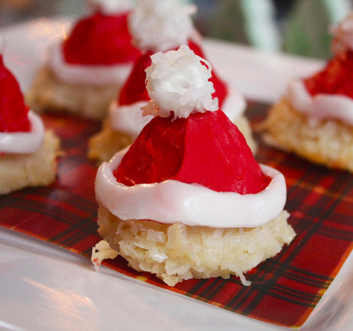 Image of coconut macaroons decorated to look like Santa Hats from Benedict Treats