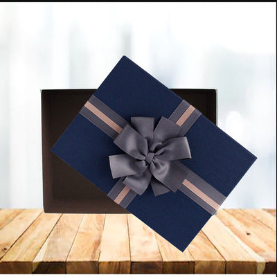 Blue lid Gift Boxes made from strong, rigid, longlisting cardboard Material. Box has elegant cream design with a chocolate brown interior, beautifully finished with a textured lid and a two tone brown ribbon bow. No assembling required.