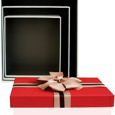set of 3 strong gift box made of hard cardboard with red lid with two tone ribbon and brown bow. its interior is black in colour and packed one inside other