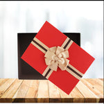 Red lid Gift Boxes made from strong, rigid, longlisting cardboard Material. Box has elegant cream design with a chocolate brown interior, beautifully finished with a textured lid and a two tone brown ribbon bow. No assembling required.