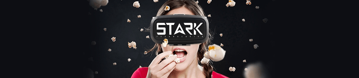 person wearing vr headset while eating popcorn