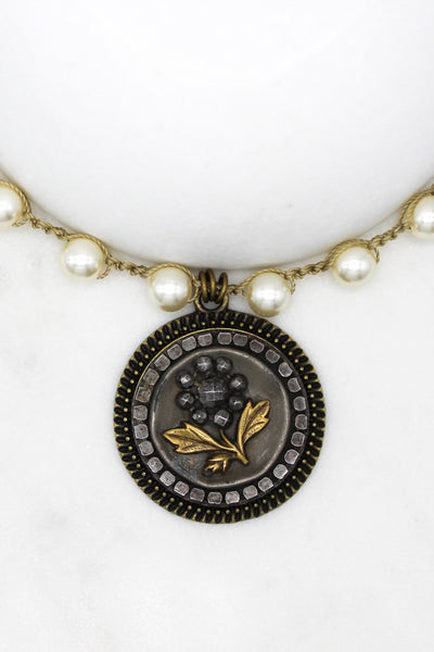 antique button necklace with black flower and gold leaves
