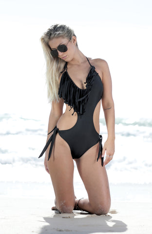 Bohemian -adding a bit of a Boho feel to our collection. This is a gorgeous black swimsuit with fringing around the bust line. With cutout sides for a flattering waistline. This swimsuit is a sure head turner. Medium coverage at the bottom.