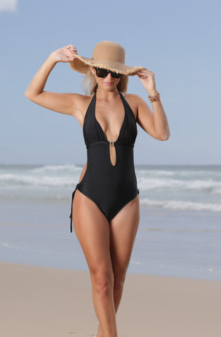 Beachcomber is a very stylish, sexy swimsuit suitable for a wide range of age groups and looks great on most body types. It's side cutouts give the waist a slimline and it's finished with a gold centrepiece. Medium coverage at the brief.
