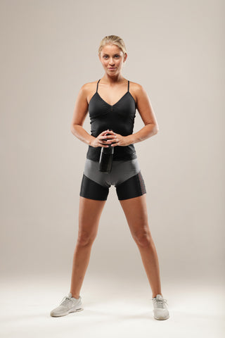 Cross Training tank-This Strappy tank is light weight, making it a good choice for those hotter days or workouts. It has removable padding to enhance your shape, it is cut to the hip and is elegantly finished at the back with strap detailing.