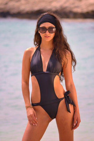 Martinque: Black sexy monokini. This is great when you feel like a little more coverage than a bikini but still the sexy look. It has padding in the halter style top and ties at the neck and back. A bikini with a wide join down the center abdomen. This gives a slimming effect and is very flattering with a lower belt tie at one side. Medium coverage on the brief.