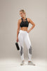 These lush opaque white leggings are detailed with black and white striped panels around the knee and the hip. Soft comfortable fabric both supportive and lifting yet durable and flexible to meet your fitness requirements. The waistband is finished slightly higher, giving support around the waist, back and hips for a flattering smoother finish.