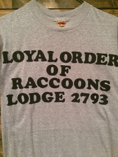 Fuzzy Letter Racoon's Lodge Tee