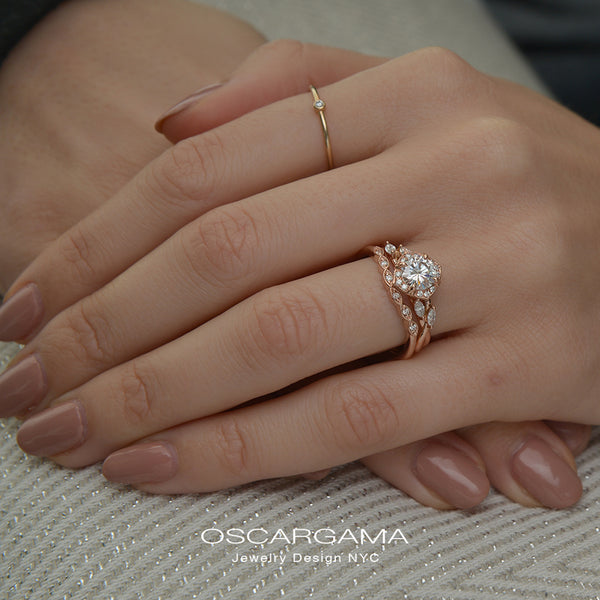 Rose gold engagement ring vintage inspired halo with a twist band  in a hand