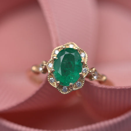 Natural oval green emerald engagement ring