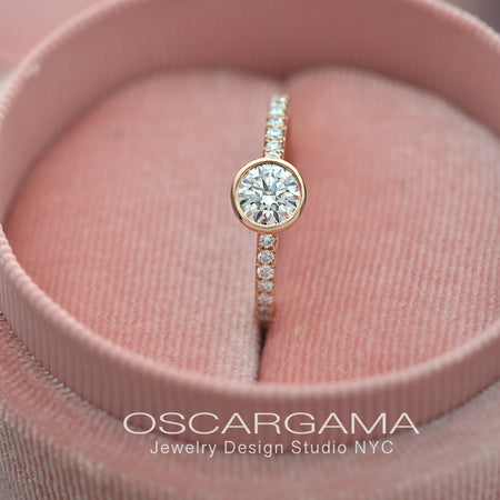 round bezel style engagement ring with pave in rose gold