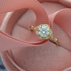 yellow gold engagement ring  round flower halo