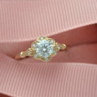 gold engagement ring flower halo