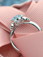 Oval blue aqua marine engagement ring front view