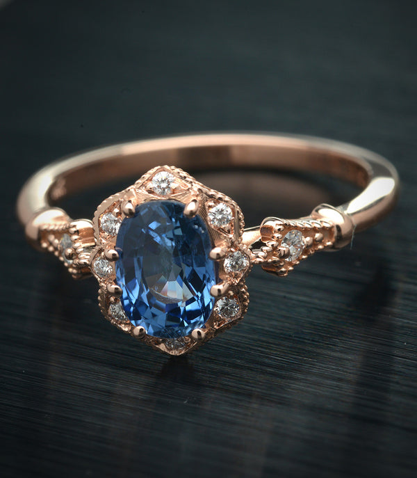 Cornflower blue sapphire Daisy oval halo engagement ring vintage inspired
