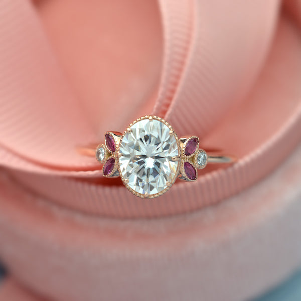 Oval engagement ring with marquise rubies in rose gold vintage inspired