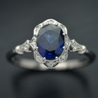 white gold halo oval flower engagement ring vintage style with blue sapphire