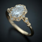 Vintage oval halo engagement ring in yellow gold