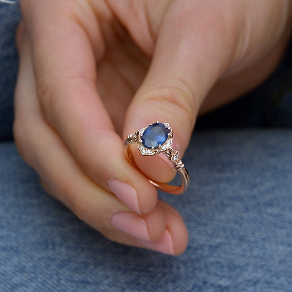 Blue Sapphire Vintage engagement Ring in hand