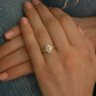 Oval Halo vintage look engagement ring in a hand