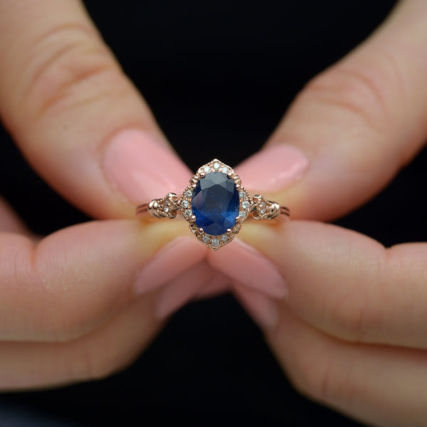 Blue Sapphire Vintage engagement Ring in hands