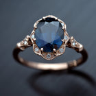 rose gold halo oval flower engagement ring vintage style with blue sapphire