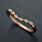 curved scalloped wedding band with 6 diamonds in rose gold