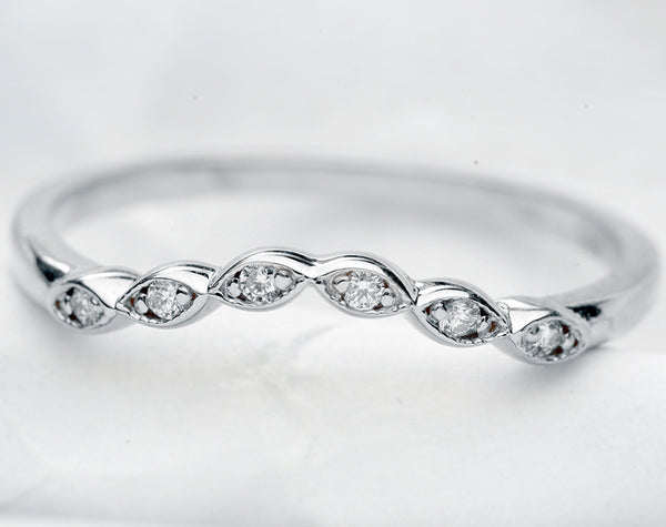 curved scalloped wedding band with 6 diamonds in white gold