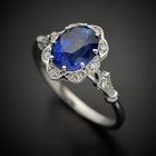 Natural blue sapphire Daisy oval halo engagement ring vintage inspired