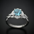 white gold aqua marine halo engagement ring twisted band