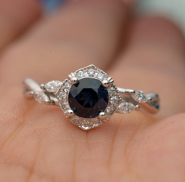 white gold blue sapphire halo engagement ring twisted band