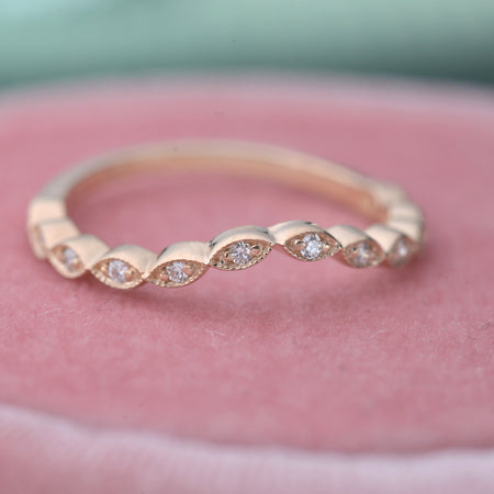 curved wedding band rose gold diamonds