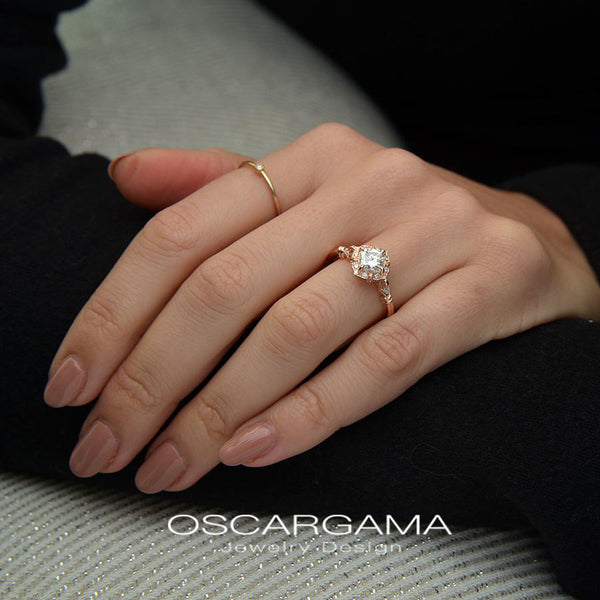 vintage cushion halo engagement ring rose gold in a hand