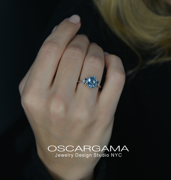 oval aqua marine ring in a model hand