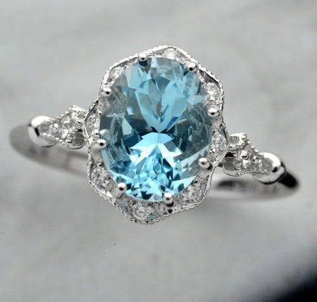 white gold Engagement Ring with blue aqua marine center stone