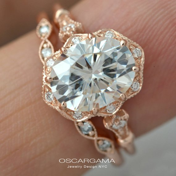 rose gold oval halo engagement ring with band