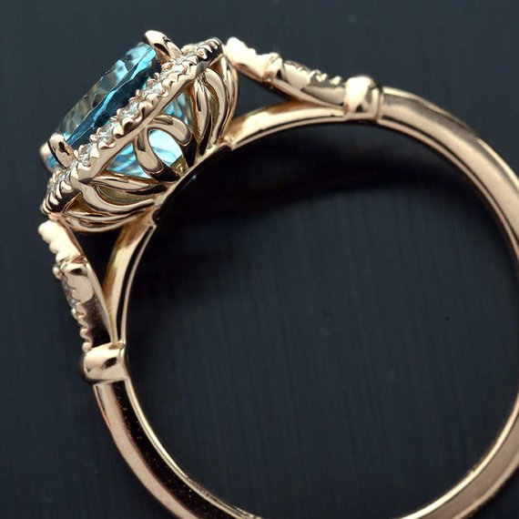 Oval aqua marine engagement ring halo in rose gold vintage inspired