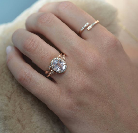 Oval pink Morganite engagement ring halo in rose gold in model hand