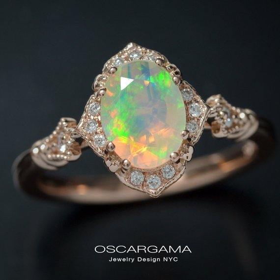 oval opal engagement ring in rose gold
