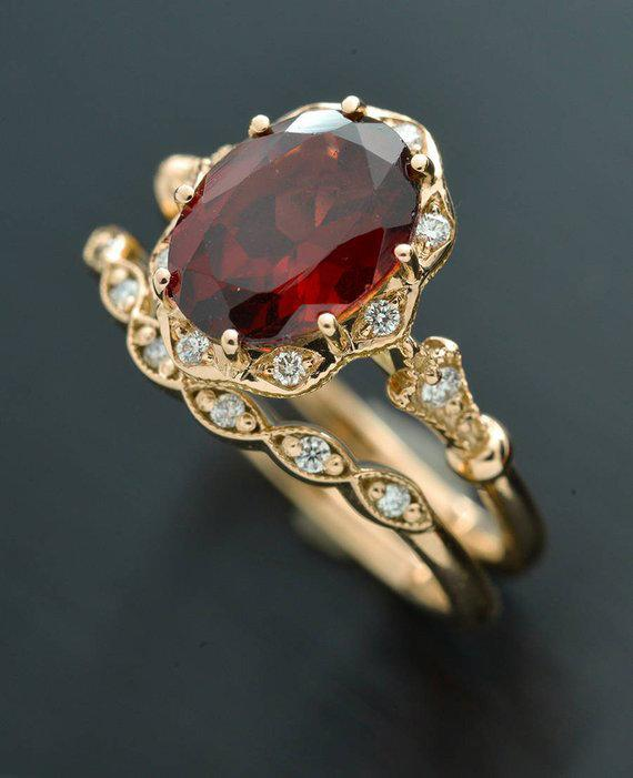 red garnet oval halo rose gold engagement ring set