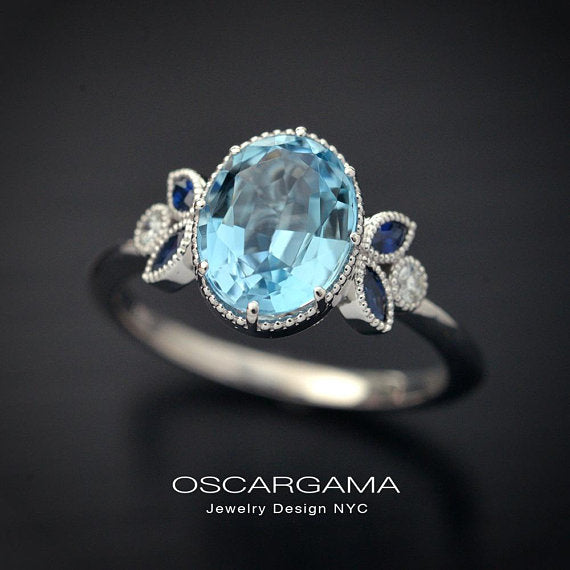 Oval blue aqua marine engagement ring with marquise sapphires