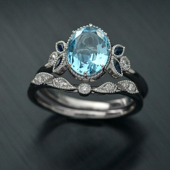 Ovaloval  blue aqua marine engagement ring and band