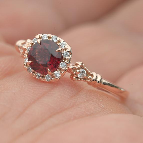 Red Garnet in a Jazzlyn Cushion Halo