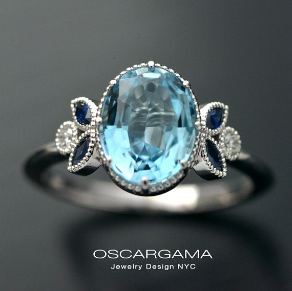 Oval Natural Aqua Marine with blue sapphire marquises