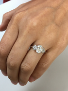 Oval Engagement Ring Vintage Inspired with marquises in a hand
