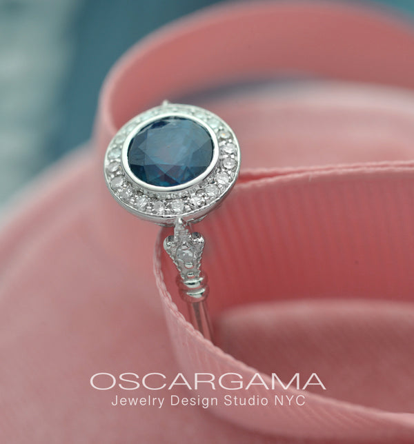 blue sapphire vintage engagement ring in white gold pink background
