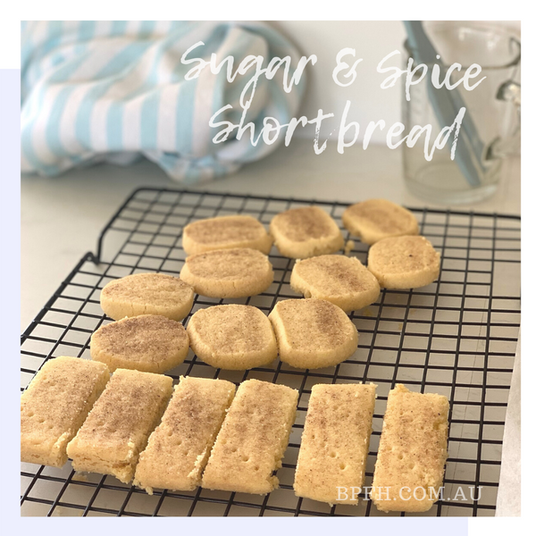 Spiced shortbread on baking tray sprinkled with Backpalate Flavour House spiced sugar.