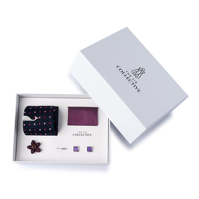 100% silk, purple polka dot tie set with a checked purple pocket square, purple flower lapel pin, silver whale tie bar and silver and purple cufflinks.